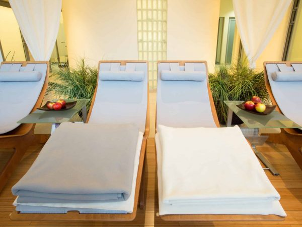 Luxury cozy spa with comfortable wooden loungers
